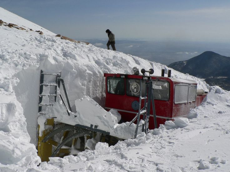 n the spring season (April-early June), the peak can see upwards of 15 feet of snow or more! This is our trusty snowplow cutting through the snow above treeline. The Railway constructed this snowplow in the 1970s, in hopes that a more powerful plow would help us stay open year-round. This 500 horse-power, 12-cylinder Cummins diesel engine plow, along with our Section Crew, have definitely served us well throughout the many years and snowstorms!