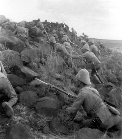 The Royal Canadian Regiment assaults a Boer position as the Anglo forces aiming to relieve the siege of Kimberly (or possibly recreate it for the camera afterwards). It was the first engagement by Canadian forces outside of North America. (McGregor Museum)