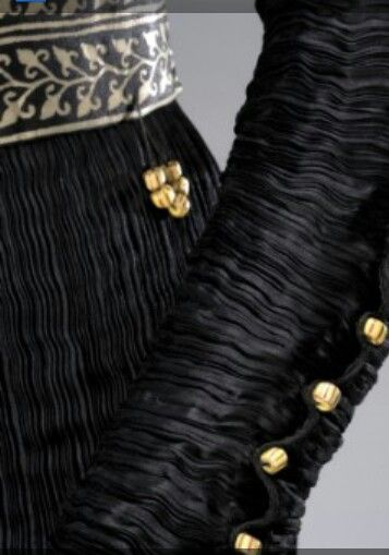 Fortuny pleating and detailing for greek characters