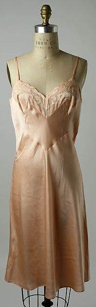 Slip Date: late 1950s Culture: French Medium: silk Dimensions: Length (from shoulder): 39 in. (99.1 cm) Credit Line: Gift of Mrs. Samuel M.V. Hamilton from the Estate of Mrs. William Coxe Wright, 1978 Accession Number: 1978.161.15