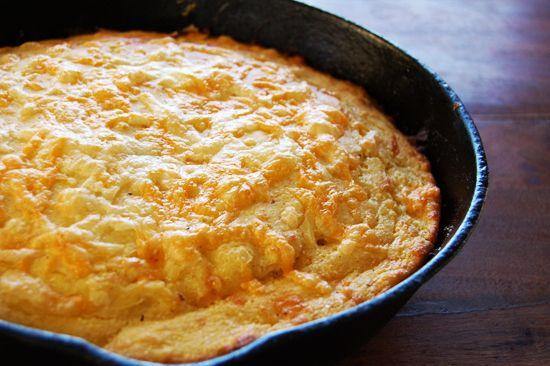 cheesy cornbread in a cast iron skillet