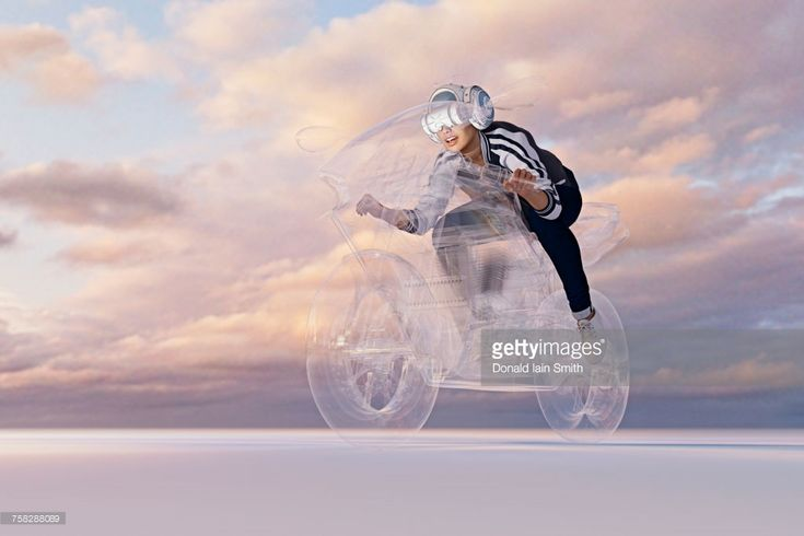 Stock Photo : Woman wearing virtual reality helmet riding motorcycle