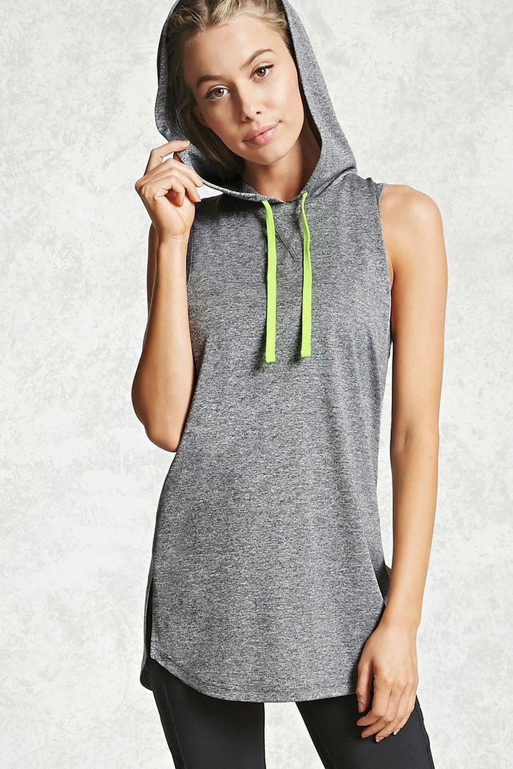 A knit athletic dress featuring contrast drawstrings, a hood, vented sides, dropped armholes, a curved hem, and moisture management.