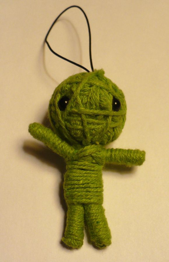 Cheap dollar craft small voodoo-doll (like the kind found in gumbull/junk machines in restaurants and stores.