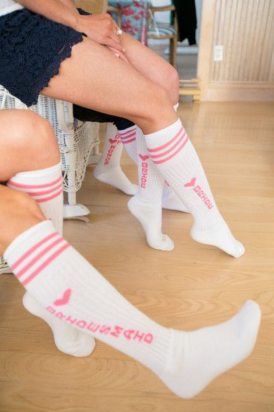Fun matching pink socks for bride and bridesmaids make a great wedding party gift! {Candace Jeffery Photography}