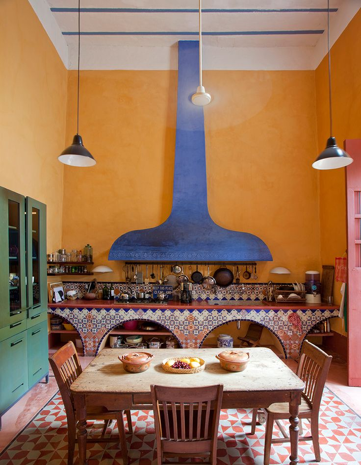Mexico home of local architecture and design duo Josefina Larraín Lagos and Salvador Reyes Ríos, the kitchen counter is decorated with traditional Talavera tiles from Puebla