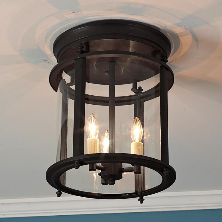 "Classic Ceiling Lantern - LargeClassic Ceiling Lantern: Enjoy the lovely candlelight effect from this highest quality solid brass lantern, especially where ceiling height is limited. Blackened bronze or natural Brass with clear curved glass. 3x60 watts. (candle base socket) (12.5""H x10.5""W)"