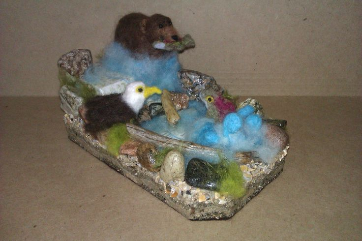 """""""Salmon Run""""; 2014; Mixed media & needle felted sculpture by Holly Boone of Polar Lights Art Studio. Currently located at the Alberta Craft Council. http://polarlightsart.wix.com/plas#!hollys-work/cq0w"""