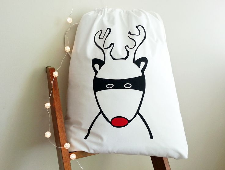 Who is this masked guy?? Santa's superhero Rudolph of course!   This Superhero is my own design and produced 100% by hand - from the stencil for the screen to the printing of the Santa Sack.  It is pre-washed and ready to use!  It is made from 300 threadcount cotton with a herringbone tape draw ...