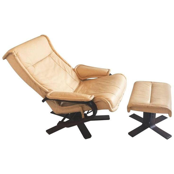 1970s Mid-Century Norwegian Leather Reclining Armchair and Footstool | From a unique collection of antique and modern armchairs at https://www.1stdibs.com/furniture/seating/armchairs/