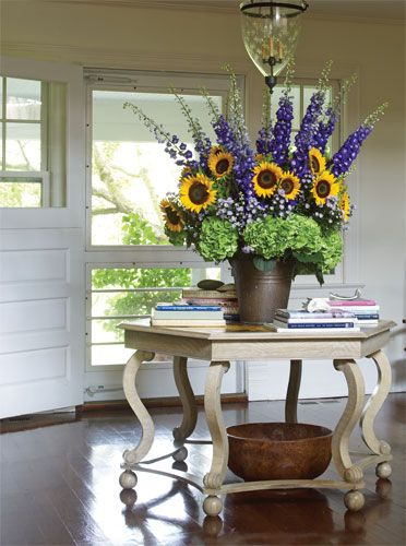 Private Collection {For this crisp, summery Southampton foyer Michael used a rustic bucket filled with sunflowers, lavender 'Monte Casion' asters, delphinium, and hydrangeas}