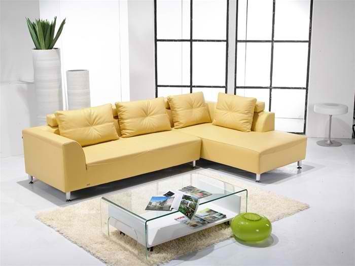 Warm Living Room Colours With Green Leather Sofas And White Wall Paint Ideas