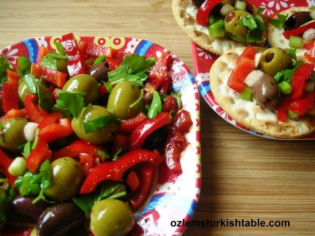 Olives salad with red peppers, spring onions and pomegranate molasses; summer on a plate!
