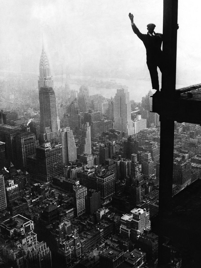 Man waving from Empire State building construction site, 1930s