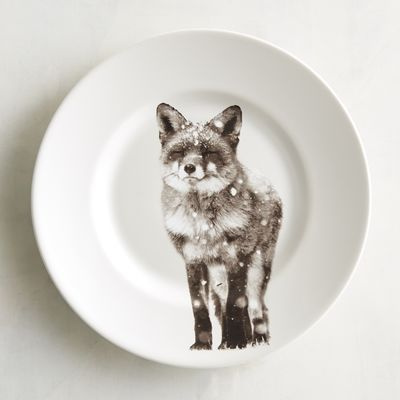 Add some wintery majesty to your table setting with our porcelain salad plate, which boasts detailed depiction of a furry forest dweller in a timeless sepia color palette.