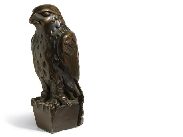 Lot 225 The iconic lead statuette of the Maltese Falcon from the 1941 film of the same name Warner Bros., 1941. Cast lead with dark patina, figure o...