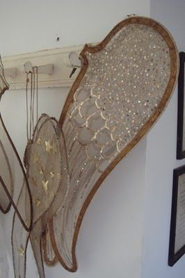Wings. Glittered and hung on a peg rack. They know they are abundant in fancy joy but they are also demure and choose to not be flaunty and jaunty-waiting patiently their turn to have a turn about the dance floor. May I have this dance?