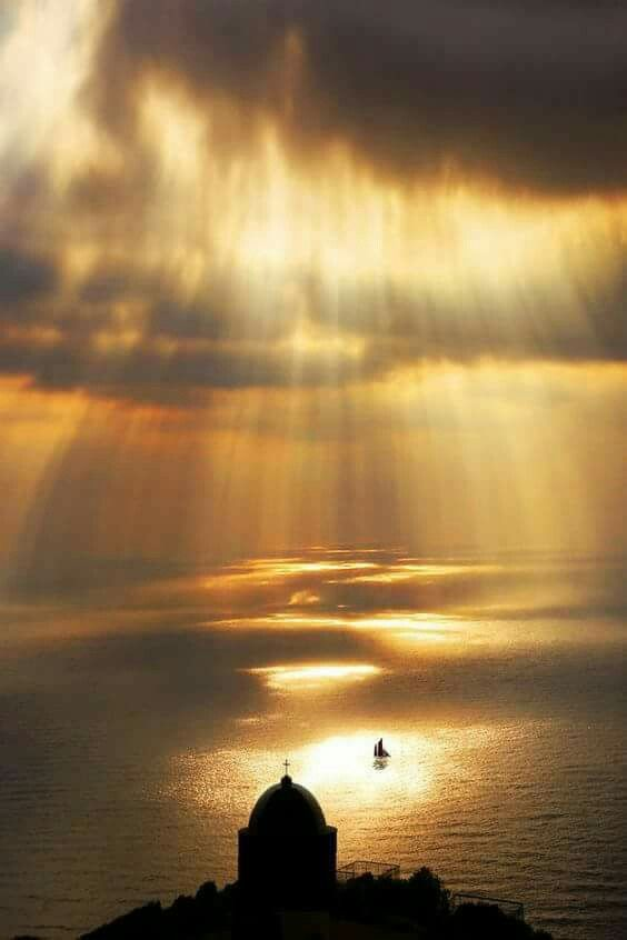 When God's hand painting! Sunset over Santorini, Greece