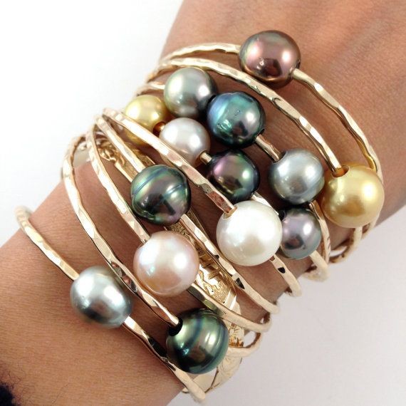 This listing is for a very SPECIAL SET of 9 bangles. These pearls are the best quality of all the pearls I have. All bangles are 12 gauge 14kt Gold Filled. Bangles are hammer to sparkle.  This SET includes 9 Bangles: 1 - Quad, 4 Pearl Bangle 10mm pink freshwater pearl, 2 - 10mm tahitian pearls, and a 10mm golden south sea pearl 3- Single AA Tahitian pearl bangles (I try to give 3 different colors/tones) 11mm 1- 2 AA Tahitian pearl bangle 10-11mm 1 - 3 AA Tahitan pearl bangle 10-11mm 1 - 11mm…