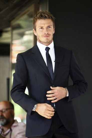 David Beckham in a black Armani suit...Very nice! Any groom would look good in a suit like this....