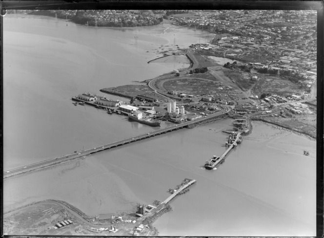 1975. Onehunga Harbour, bridge connecting Onehunga and Mangere, second bridge under construction, Auckland. Whites Aviation Ltd :Photographs. Ref: WA-72748-G. Alexander Turnbull Library, Wellington, New Zealand. http://natlib.govt.nz/records/22810898.