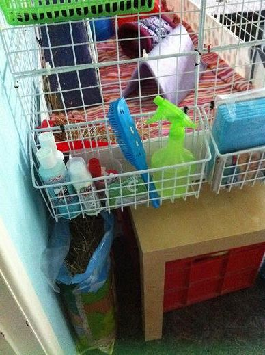 storage idea for bunnies supplies, attach baskets to cage sides
