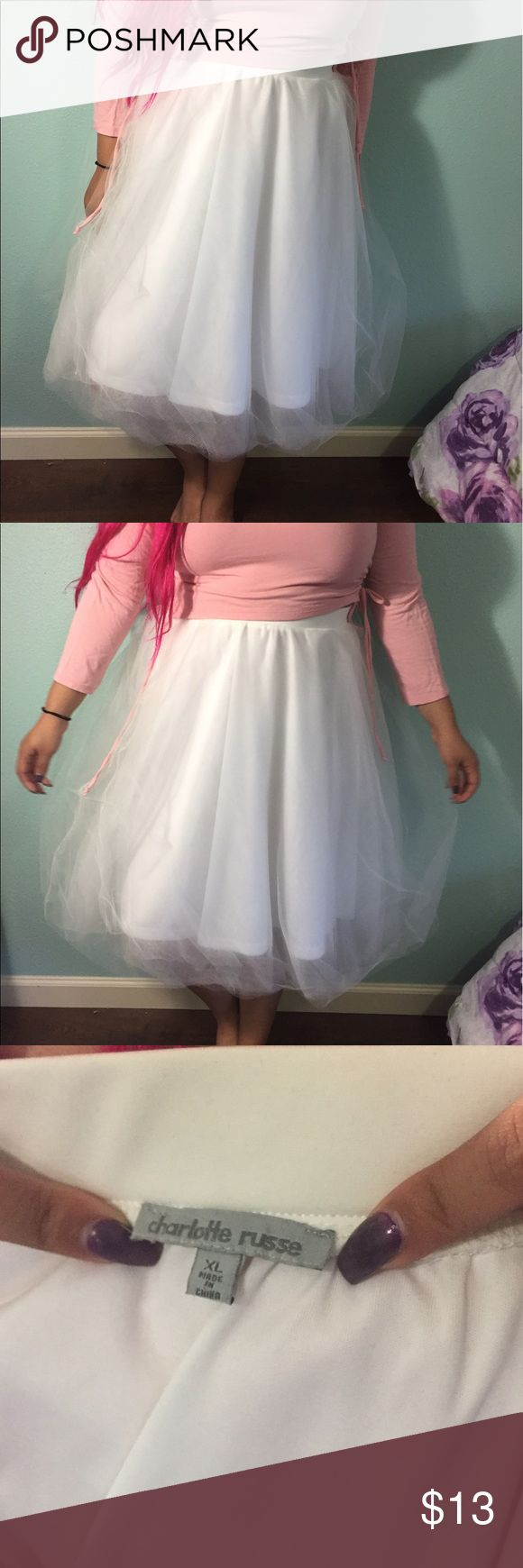 Tulle ballerina skirt Tea length tulle skirt. The waistband is thick but stretches a good amount. The lining is nice enough that it isn't see-through. Charlotte Russe Skirts Midi