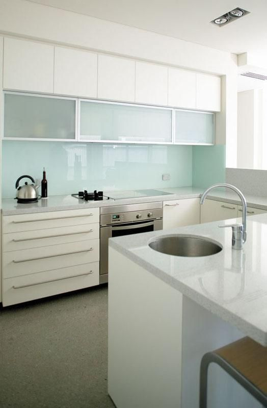 white cabinets, glass wall cabinets, mixed wall cabinets glass/solid, circle sink, cooktop, blue backsplash