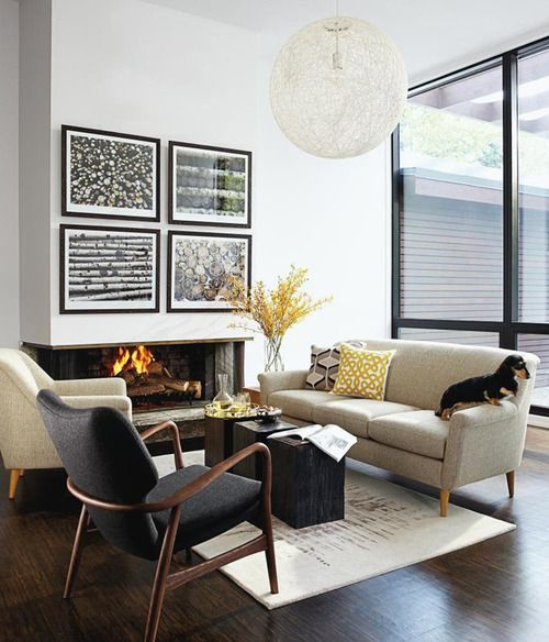 Hardwood floors, mcm furnishings, fireplace, w/ b&w artwork... amazing living room/ sitting area