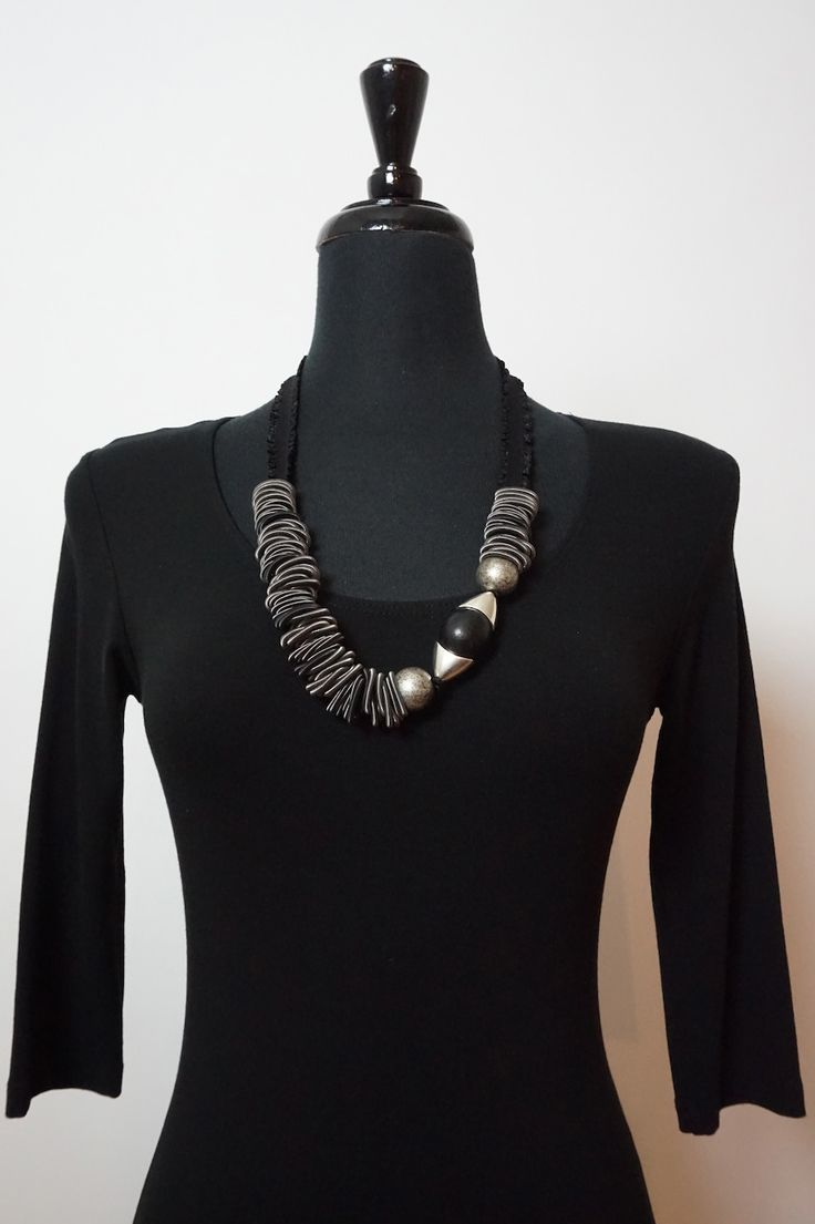 Lousje & Beans new Unique Canadian Made Jewelry Collection....Ruby....  Available here: http://www.lousjeandbean.ca/necklaces/ #canadianmade #uniquejewelry #lousjeandbean #ruby #dreamball #necklaces #funkyjewelry #pianowire #woodbeads #silver