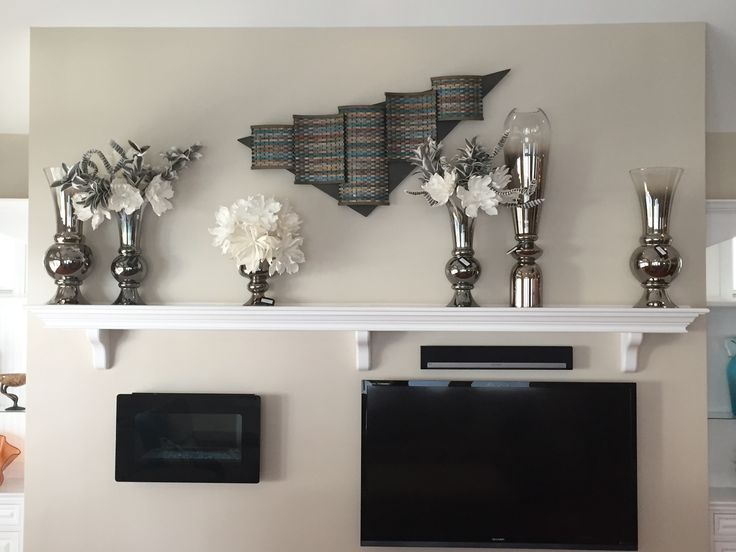 Awesome submission from Yeager Design & Interiors of a Contemporary Mantle setting they designed using our Metallic glass vases