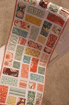 """Table Tiles Tutorial - using """"Moda Candy Bars' - 5"""" x 2.5"""" precuts.  This would make a nice baby quilt using a Charm Pack - cut in half.   This is raw edge quilt as you go!"""