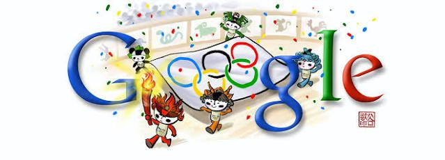 Beijing olympics mascots with torch and olympic flag