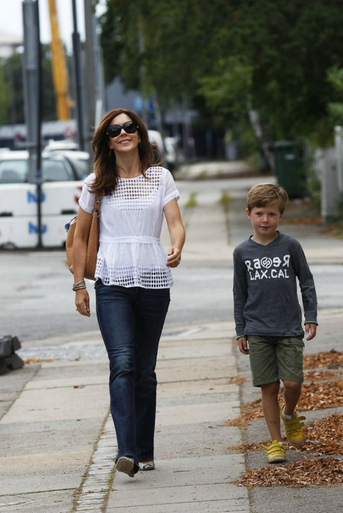 Princess Mary of Denmark. So natural. Christian at 'that age' when he doesn't want to hold hands with Mum on a stroll.