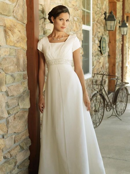 this is the closest I've seen yet to my own wedding dress.  add long sleeves, peasant bodice, and square neck.