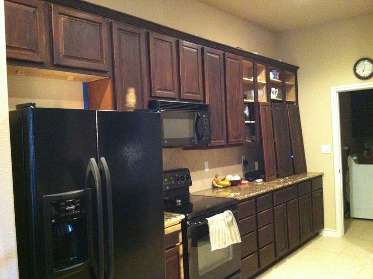 Orange Oak Kitchen Cabinets With Black Appliances