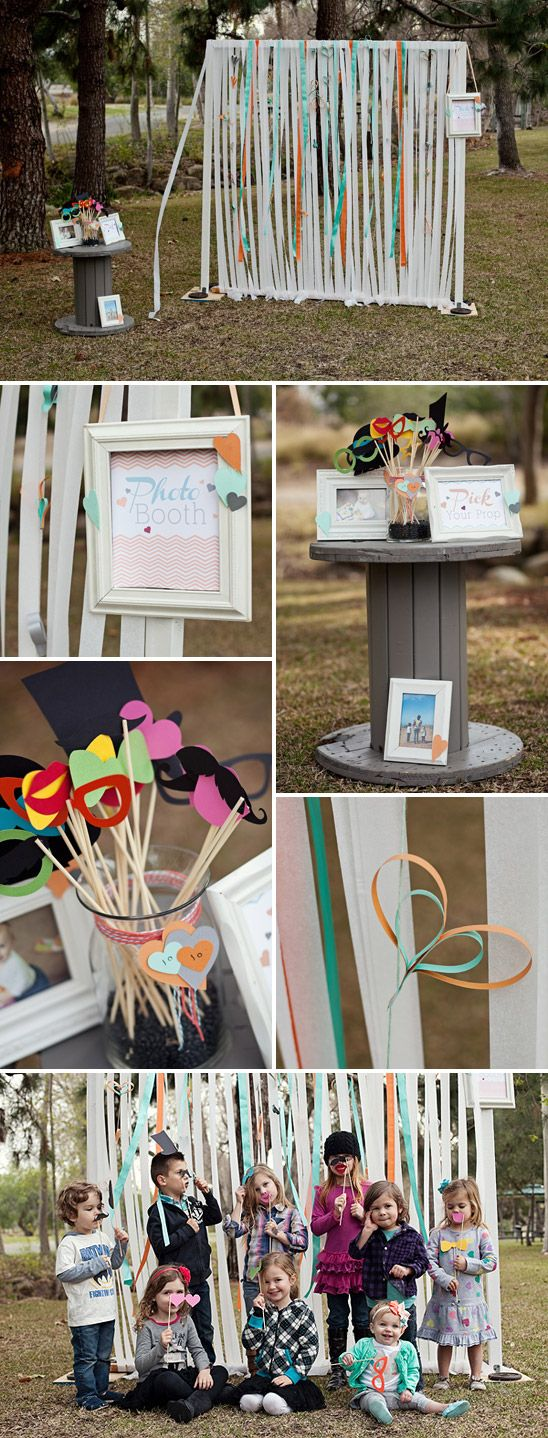 i like the idea of having a little photo booth of sorts.. whether it is something solid, or just a big empty frame being held up. and, of course, the props.