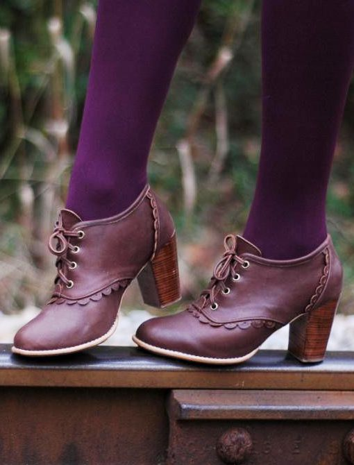 Burgundy Oxfords and purple tights.