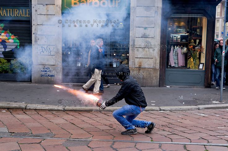 Milan, May 1, 2015 Mayday NoExpo Clashes protesters against police during the demonstration in downtown Milan, to protest against Universal Exposition Milano 2015. Rocket fire against the police