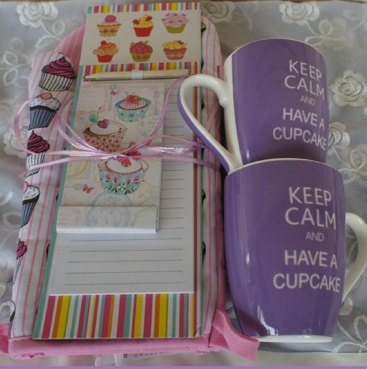 """Love of Cupcakes Gift Pack includes:2 Cupcake design oven mitts2 Mugs Purple with words """"Keep Calm and Love Cupcakes""""1 Cupcake design Magnetic Notepad1 Cupcake design small notepadPostage to anywhere in Australia.Complimentary Gift Wrapping with Quality Brown Wrapping and Ribbon."""
