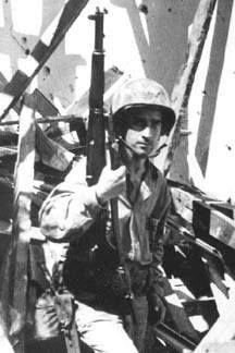 Sergeant Carrol Williford of US 3rd Marine Division in a ruined chapel with his M1 Garand rifle near the Asan beachhead Guam Mariana Islands 3 August 1944.
