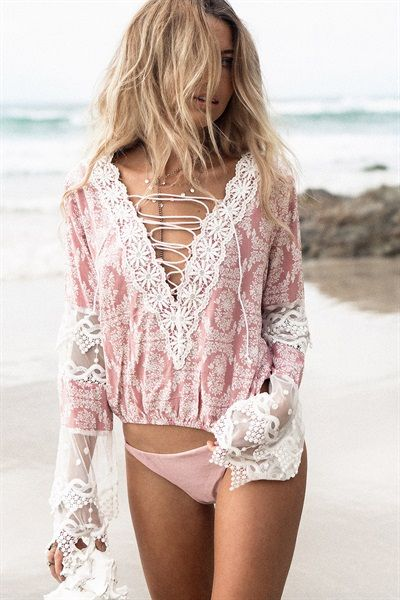 We are crushing over this one! The Eloquence Top is made from a lightweight pink and white printed fabric and features sheer mesh and lace sleeve panels, lace trim on bust, deep V neckline with lace up detailing. Hemline of top slightly elasticated. Pair with shorts or flare pants! Exclusively designed by Sabo Skirt.