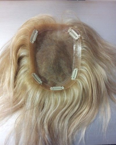 Thinning hair? Order a custom, human hair topper from Compassionate Creations.