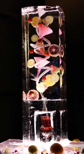 An ice sculpture that chills your guests' drinks on the way down! Awesome!! Maybe flowers instead of the fruit.