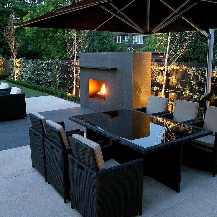 Contemporary Garden. Love this outdoor fireplace! Would like the seating closer to it to take advantage of the warmth.