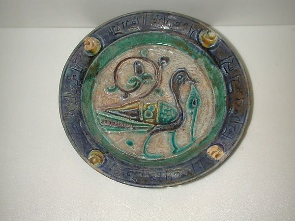 Dish, Date: 12th century Geography: Syria Culture: Islamic Medium: Stonepaste; carved, incised, polychrome painted under a transparent glaze (Laqabi ware)