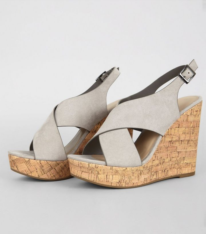 L2017 http://www.newlook.com/row/womens/footwear/shoes/grey-suedette-cork-wedge-heels/p/517580904?comp=Browse