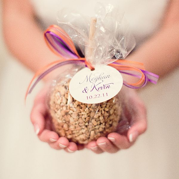 Caramel Apple Favors    Caramel apples adorned with orange and purple ribbons and a custom favor tag.