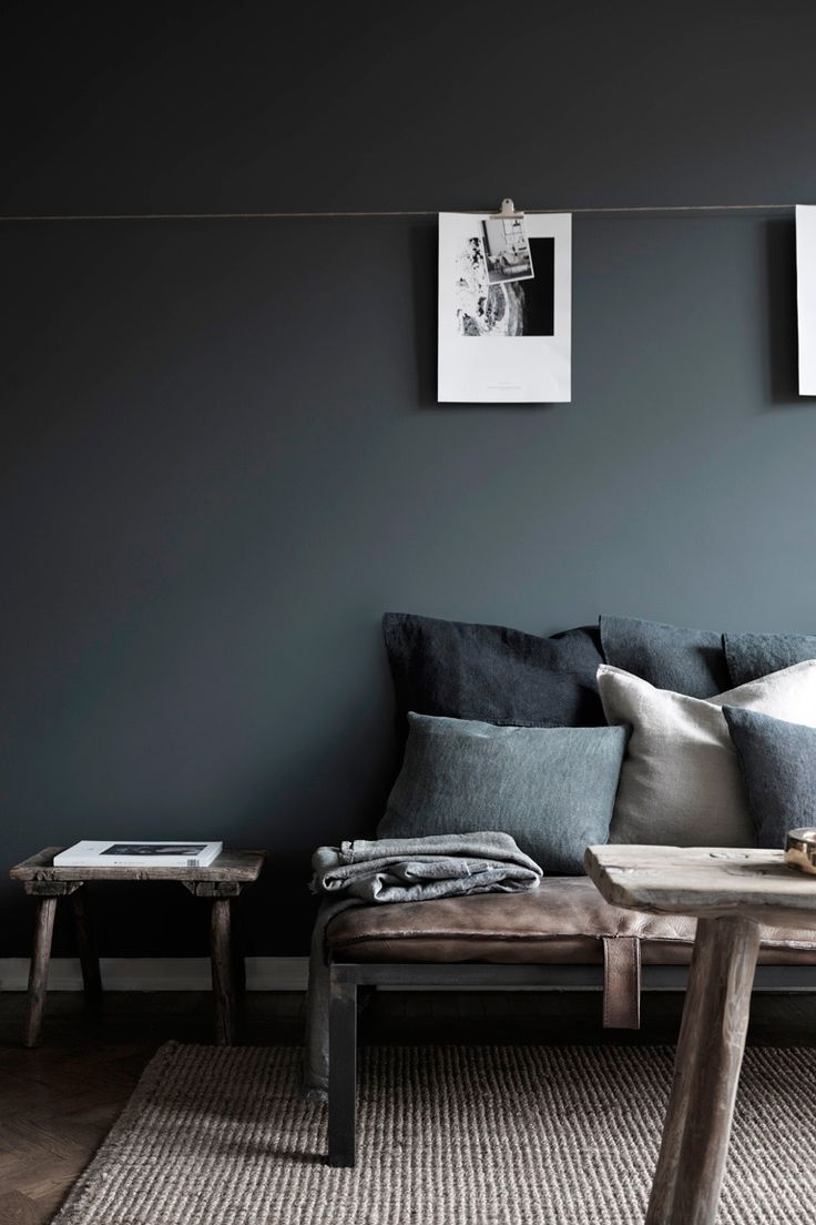 Dark gray living space with an industrial bench