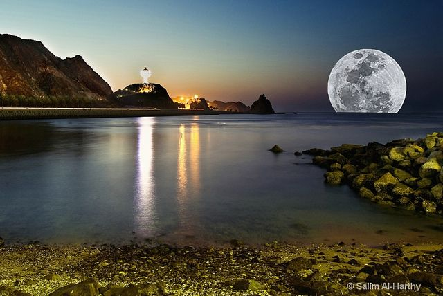 "SuperMoon at Kalboo Beach, Muscat, Oman. The name SuperMoon was coined by astrologer Richard Nolle in 1979, defined as:  "" ...a new or full moon which occurs with the Moon at or near (within 90% of) its closest approach to Earth in a given orbit (perigee). In short, Earth, Moon and Sun are all in a line, with Moon in its nearest approach to Earth """